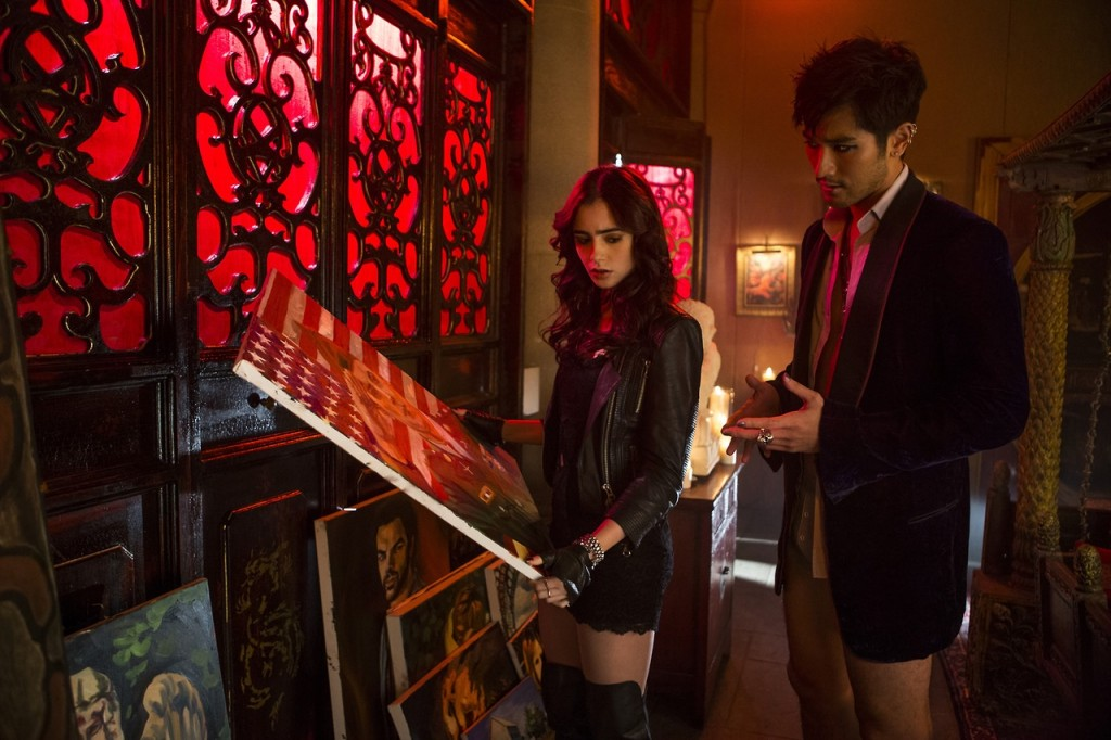 Top Ten characters who looked nothing like I pictured in their TV/movie adaptations: Lily Collins and Godfrey Gao as Clary and Magnus in 'The Mortal Instruments'
