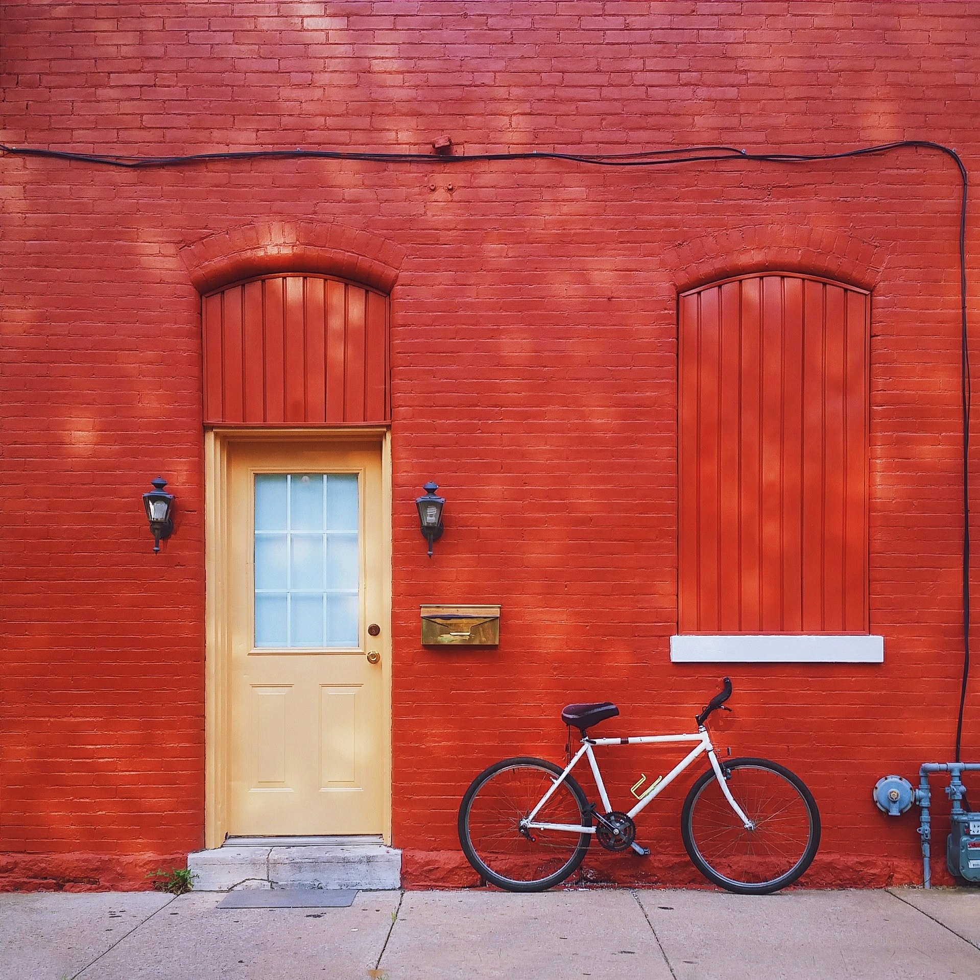 Red wall and bicycle